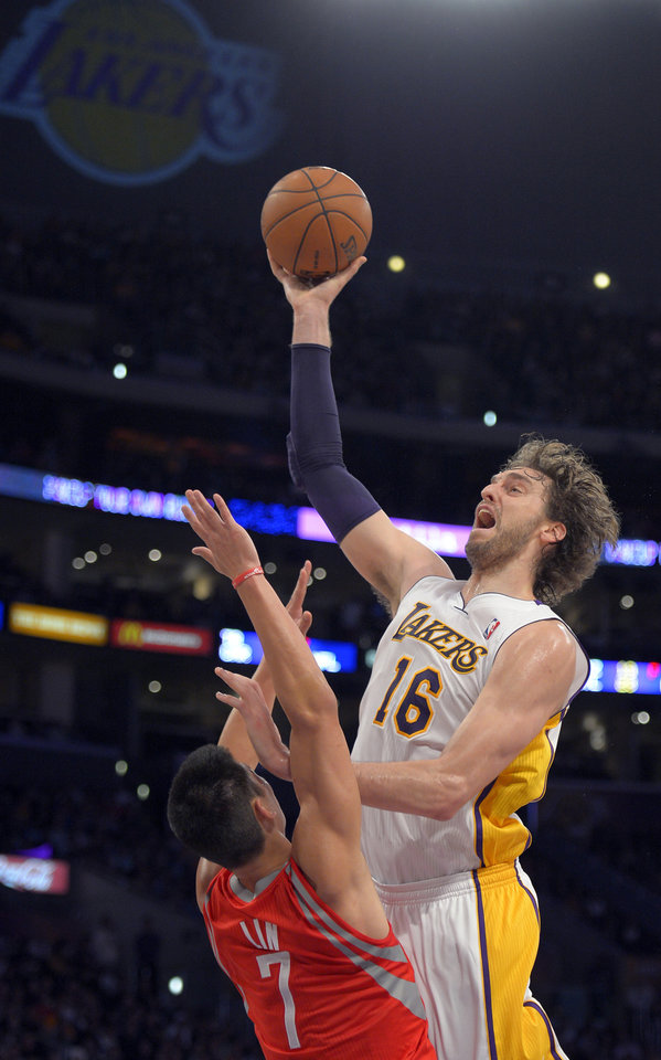Los Angeles Lakers forward Pau Gasol, right, of Spain, puts up a shot as Houston Rockets guard Jeremy Lin defends during the first half of their NBA basketball game against the Houston Rockets, Sunday, Nov. 18, 2012, in Los Angeles. (AP Photo/Mark J. Terrill)
