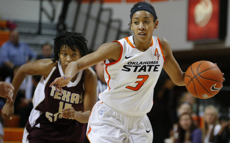 Photo - Oklahoma State's Tiffany Bias (3) drives past Texas State's Taylor McGilbra (14) during a women's college basketball game between Oklahoma State University and Texas State at Gallagher-Iba Arena in Stillwater, Okla., Wednesday, Nov. 28, 2012.  Photo by Bryan Terry, The Oklahoman
