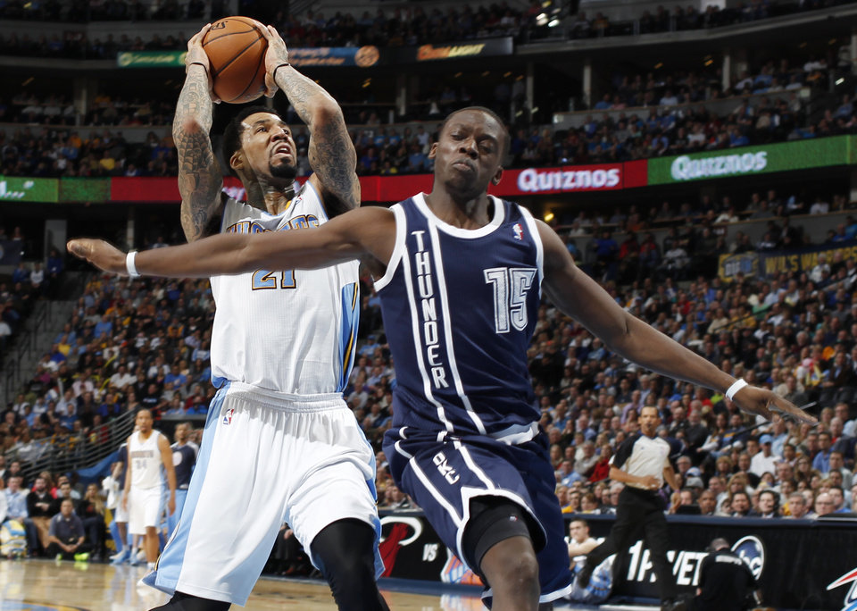 Denver Nuggets forward Wilson Chandler, left, is fouled by Oklahoma City Thunder guard Reggie Jackson in the third quarter of the Nuggets\' 105-103 victory in an NBA basketball game in Denver on Friday, March 1, 2013. (AP Photo/David Zalubowski) ORG XMIT: CODZ124