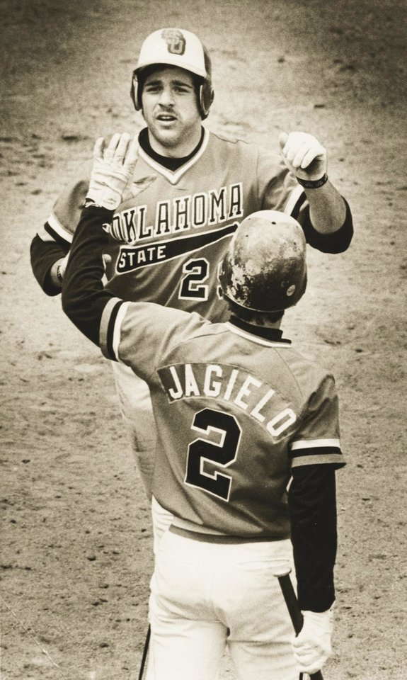 Photo - OSU's Pete Incaviglia is greeted at the plate after one of his 29 home runs last year. (STAFF PHOTO BY JIM BECKEL) (Photo shot April 9, 1984)