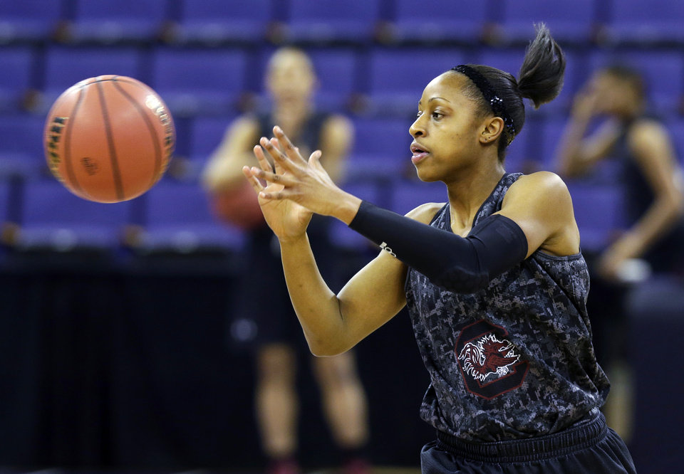 Photo - South Carolina guard Tiffany Mitchell reaches for a pass during practice at the NCAA women's college basketball tournament, Saturday, March 22, 2014, in Seattle. South Carolina is scheduled to play Cal State Northridge in a first-round game on Sunday. (AP Photo/Ted S. Warren)