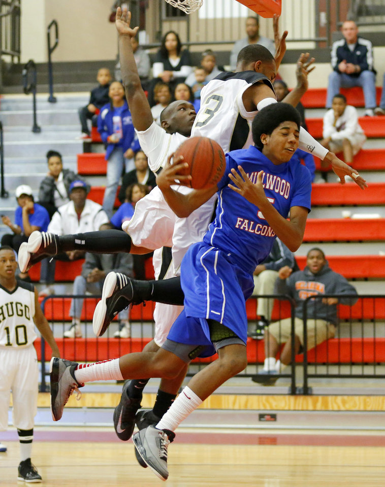 Millwood\'s Ashford Golden runs into Hugo\'s Kameron Cooper, center, and Jordan Stafford during a Class 3A boys state basketball tournament game between Hugo and Millwood at Yukon High School in Yukon, Okla., Thursday, March 7, 2013. Photo by Bryan Terry, The Oklahoman