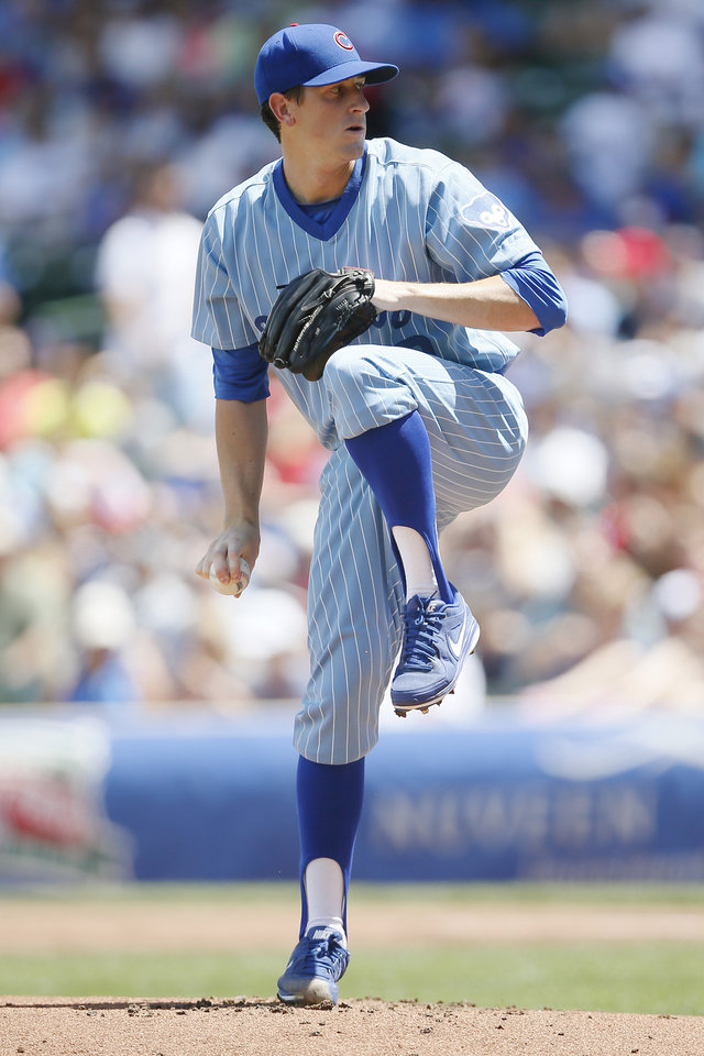 Photo - Chicago Cubs starting pitcher Kyle Hendricks delivers against the St. Louis Cardinals during the first inning of a baseball game on Sunday, July 27, 2014, in Chicago. (AP Photo/Andrew A. Nelles)
