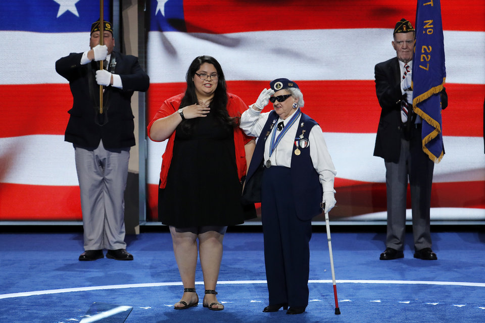 Photo - Youngest delegate 17-year-old Clarissa Rodriguez of Texas and the oldest delegate 93-year-old Ruby Gilliam of Ohio deliver the pledge of Allegiance during the first day of the Democratic National Convention in Philadelphia , Monday, July 25, 2016. (AP Photo/J. Scott Applewhite)