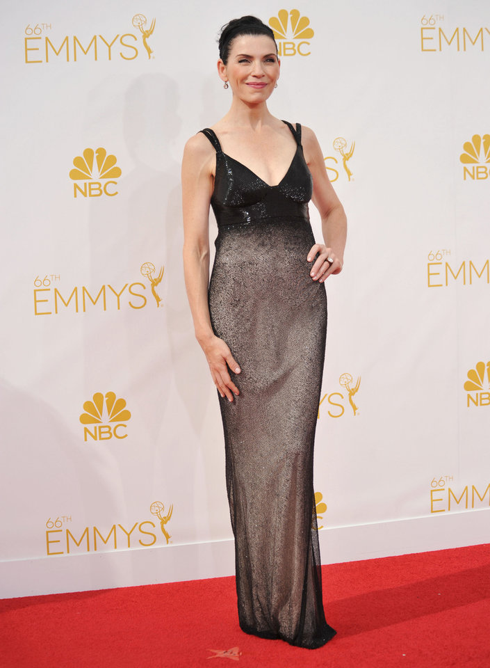 Photo - Julianna Margulies arrives at the 66th Annual Primetime Emmy Awards at the Nokia Theatre L.A. Live on Monday, Aug. 25, 2014, in Los Angeles. (Photo by Richard Shotwell/Invision/AP)