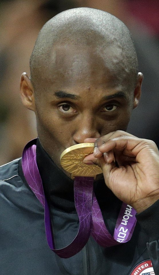 United States' Kobe Bryant kisses his gold medal after the men's gold medal basketball game at the 2012 Summer Olympics, Sunday, Aug. 12, 2012, in London. AP photo