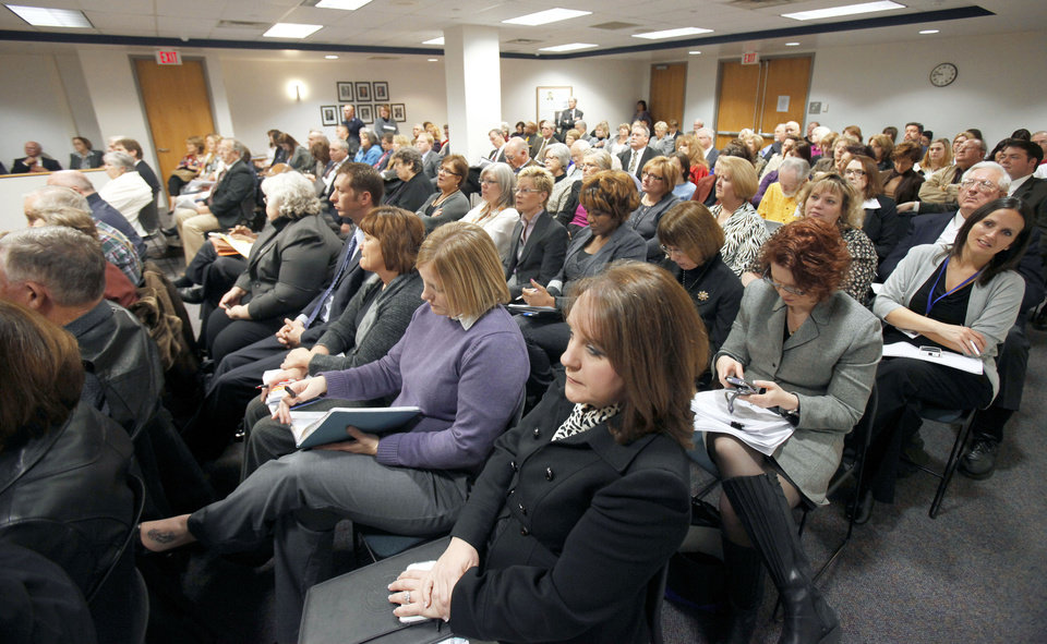 The meeting room is filled Tuesday as DHS Director Howard Hendrick announces his retirement during a meeting of the Department of Human Services in  Oklahoma City. Photo By Paul Hellstern, The Oklahoman