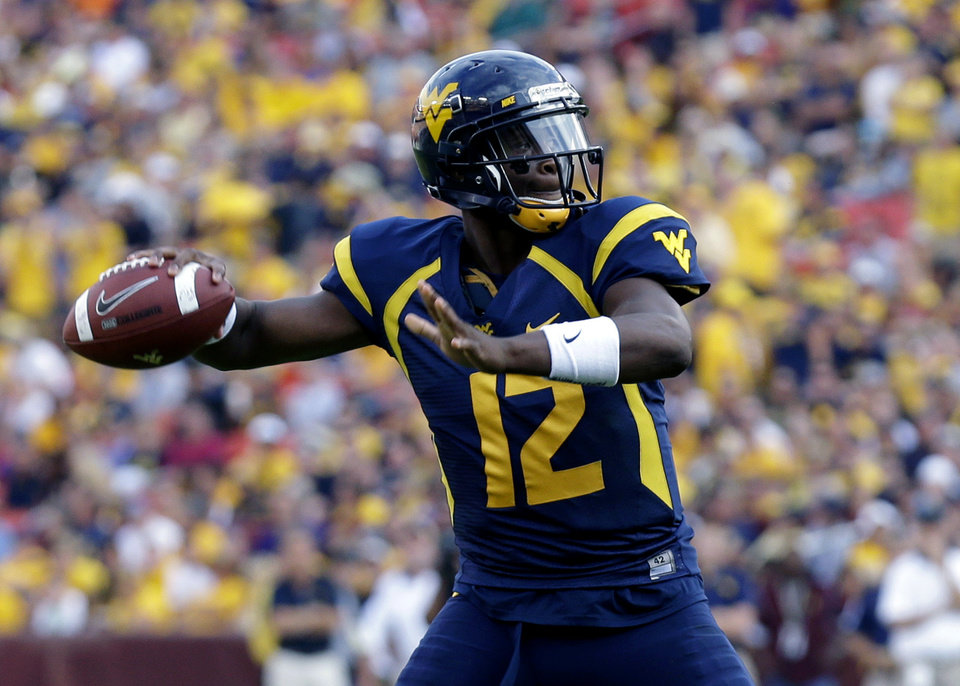 Photo - West Virginia quarterback Geno Smith is 66-of-75 passing for 734 yards and nine touchdowns through two games. (AP Photo/Alex Brandon, File)