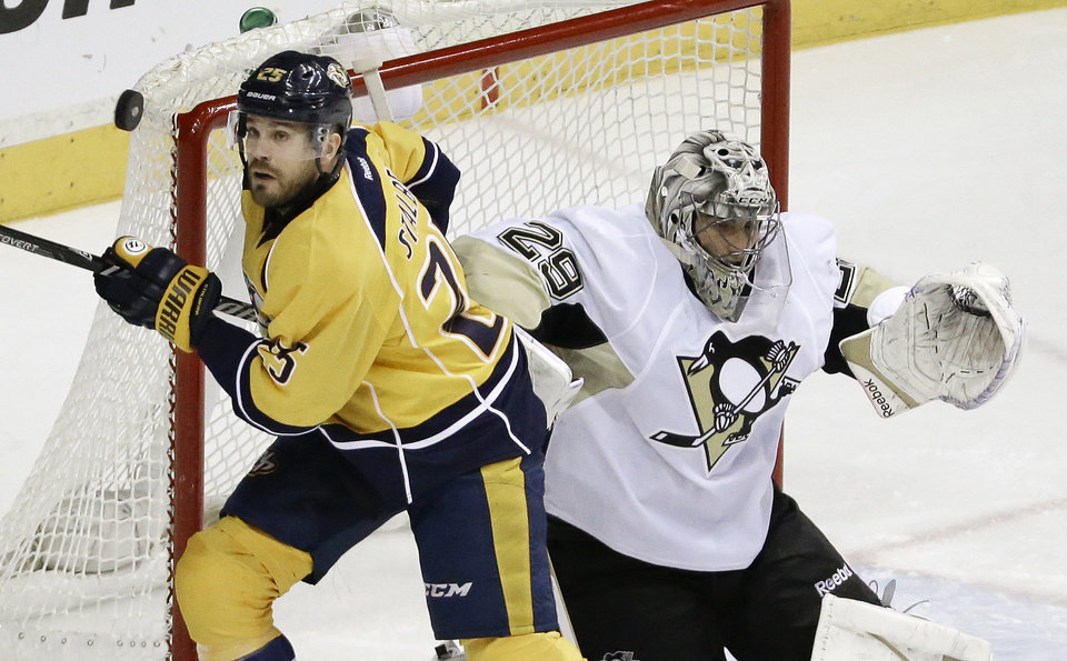 Photo - Nashville Predators forward Viktor Stalberg (25), of Sweden, chases a puck in front of Pittsburgh Penguins goalie Marc-Andre Fleury (29) in the second period of an NHL hockey game Tuesday, March 4, 2014, in Nashville, Tenn. (AP Photo/Mark Humphrey)