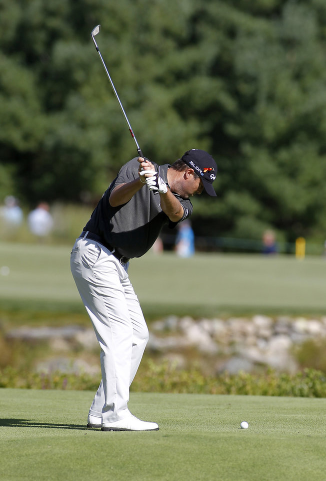 Photo - Ryan Palmer hits his third shot on the second hole during the first round of the Deutsche Bank Championship golf tournament in Norton, Mass., Friday, Aug. 29, 2014. (AP Photo/Stew Milne)