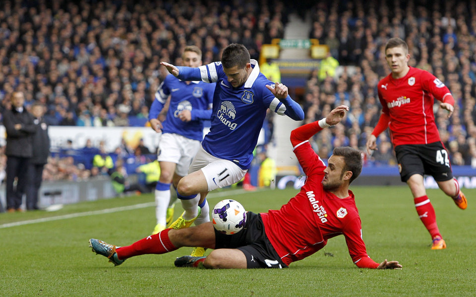 Photo - Everton's Kevin Mirallas , left, and Cardiff City's Juan Cala battle for the ball during their English Premier League soccer match at Goodison Park, Liverpool, England, Saturday, March 15, 2014. (AP Photo/Peter Byrne, PA Wire)    UNITED KINGDOM OUT   -  NO SALES   -   NO ARCHIVES