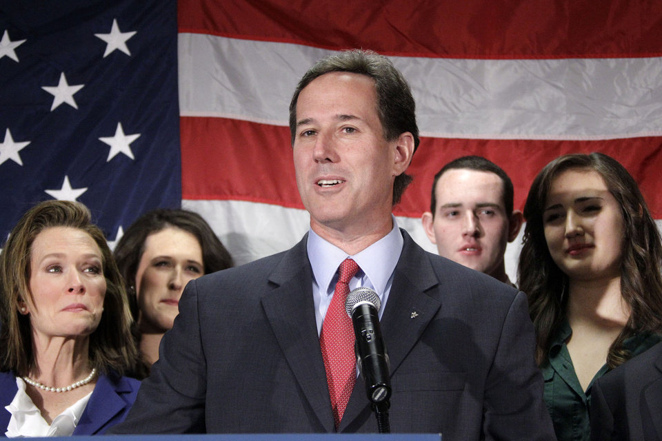 Surrounded by his family, former Pennsylvania Sen. Rick Santorum announces he is suspending his candidacy for the presidency effective today, Tuesday, April 10, 2012, in Gettysburg, Pa.  (AP Photo/Gene J. Puskar) ORG XMIT: PAGP103