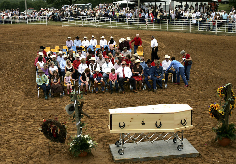 Photo - Family and friends gather at the Jim Shoulders Living Legends Rodeo Arena during funeral services for Jim Shoulders in Henryetta, Okla., on Sunday,  June 24, 2007. By John Clanton, The Oklahoman