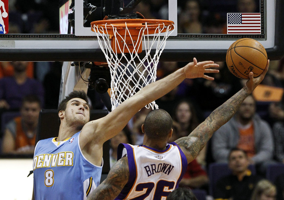 Phoenix Suns\' Shannon Brown (26) drives around Denver Nuggets\' Danilo Gallinari (8), of Italy, to score in the first half during an NBA basketball game Monday, Nov. 12, 2012, in Phoenix. (AP Photo/Ross D. Franklin)