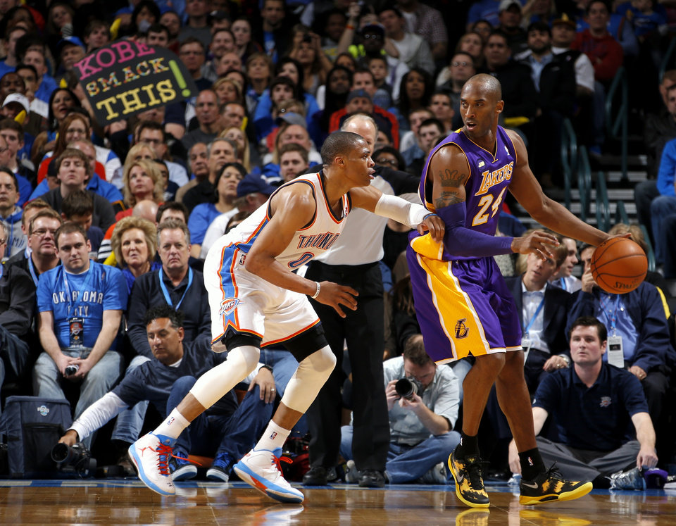 Oklahoma City's Russell Westbrook defends Los Angeles' Kobe Bryant during an NBA basketball game between the Oklahoma City Thunder and the Los Angeles Lakers at Chesapeake Energy Arena in Oklahoma City, Tuesday, March 5, 2013. Photo by Bryan Terry, The Oklahoman