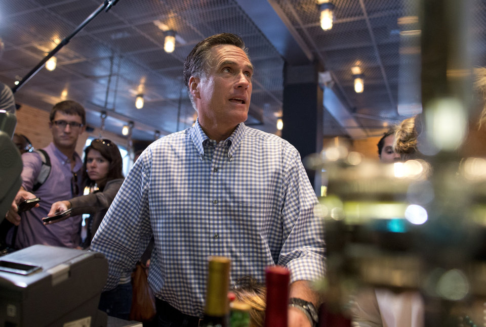 Photo -   Republican presidential candidate, former Massachusetts Gov. Mitt Romney looks at a menu as he orders dinner at BurgerFi on Sunday, Oct. 21, 2012 in Delray Beach, Fla. (AP Photo/ Evan Vucci)