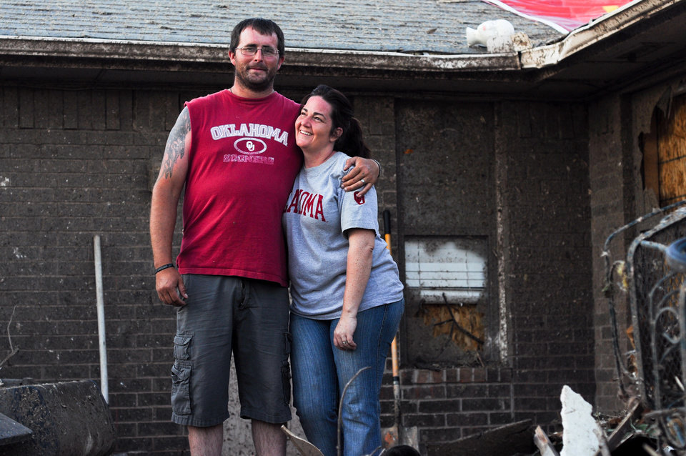 Photo - Michael Roberts and his wife Summer Roberts pose for a portrait on the back yard patio of their house which was devastated by the May 20, 2013 tornados in Moore, Okla. Photo by KT King, The Oklahoman