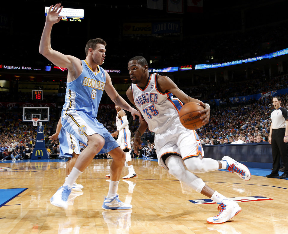 Photo - Oklahoma City's Kevin Durant (35) goes around Denver's Danilo Gallinari (8) during an NBA basketball game between the Oklahoma City Thunder and the Denver Nuggets at Chesapeake Energy Arena in Oklahoma City, Tuesday, March 19, 2013. Photo by Bryan Terry, The Oklahoman