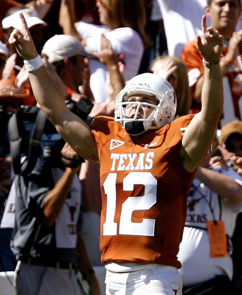Photo - Texas' Colt McCoy (12) reacts after the Longhorns scored a touchdown during the Red River Rivalry college football game between the University of Oklahoma Sooners (OU) and the University of Texas Longhorns (UT) at the Cotton Bowl in Dallas, Texas, Saturday, Oct. 17, 2009. Photo by Chris Landsberger, The Oklahoman