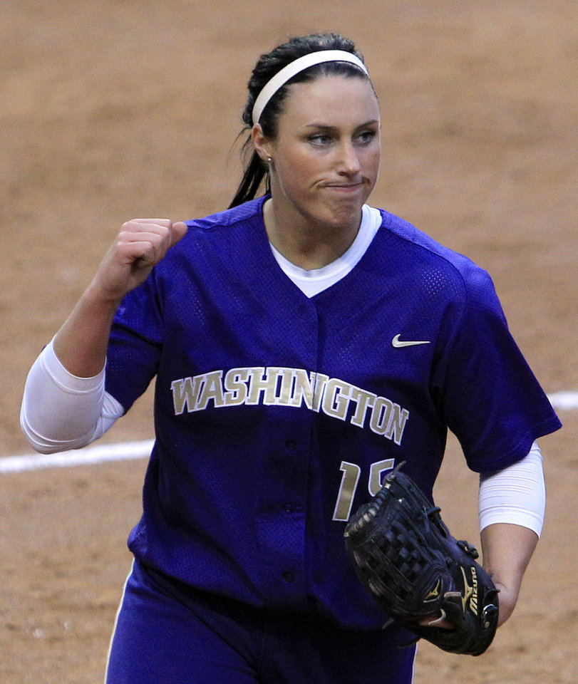 Photo - COLLEGE SOFTBALL: Washington starting pitcher Danielle Lawrie pumps her fist after the final out against the University of Oklahoma (OU) in an NCAA super regional softball game Friday, May 28, 2010, in Seattle. Washington won 3-0 to force a deciding third game later in the evening. (AP Photo/Elaine Thompson) ORG XMIT: WAET114