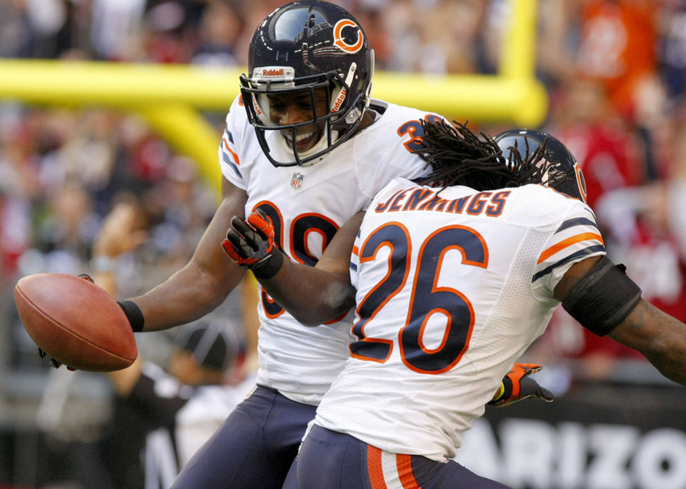 Photo - Chicago Bears defensive back Zack Bowman (38) celebrates his touchdown with teammate Tim Jennings (26) against the Arizona Cardinals during the first half of an NFL football game, Sunday, Dec. 23, 2012, in Glendale, Ariz. (AP Photo/Rick Scuteri)
