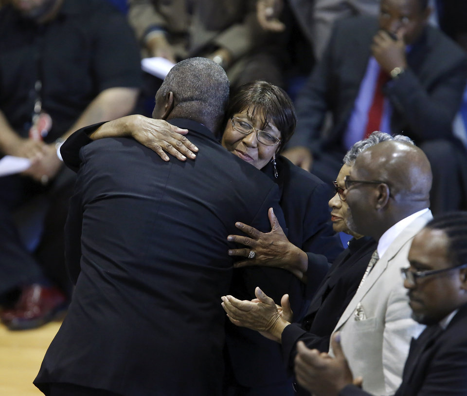 Fred Carter receives hugs and applause after delivering the eulogy for his dad. About 400 family and friends gathered inside the Millwood High School Fieldhouse on Tuesday, Sep, 25, 2012, to honor the life and say farewell to Joseph D. Carter, Sr. at a funeral service that was sentimental and touching, but also full of joy and laughter. Carter is survived by a wife and their 11 children as well as 46 grandchildren, 35 great-grandchildren and 10 great-great-grandchildren. Photo by Jim Beckel, The Oklahoman.
