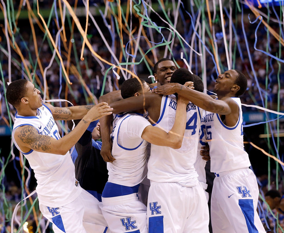 FOR USE AS DESIRED FOR KENTUCKY YEAR END STORIES   FILE -Kentucky players celebrate at the end of the NCAA Final Four tournament college basketball championship game against Kansas Monday, April 2, 2012, in New Orleans. Kentucky won 67-59. (AP Photo/David J. Phillip, File)