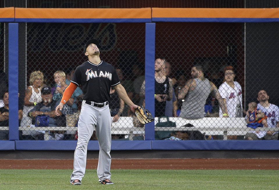 Photo - Miami Marlins right fielder Giancarlo Stanton  watches as New York Mets' Lucas Duda's two-run home run sails over the right field wall in the third inning of a baseball game, Friday, July 11, 2014, in New York. (AP Photo/Julie Jacobson)
