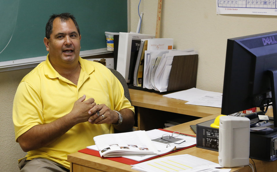 Aaron Cosar is pictured in his classroom at The Education and Employment Ministry (TEEM), where Cosar works as a life-skills instructor, in Oklahoma City, Monday, June 24, 2013. Former Oklahoma Gov. Brad Henry commuted the life sentence of Cosar and signed his parole while he was governor. (AP Photo/Sue Ogrocki)
