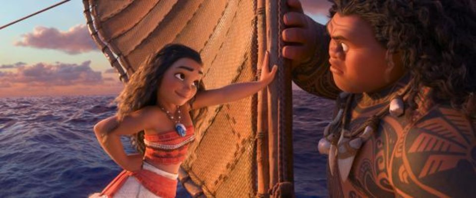 Photo - Moana, voiced by Auli'i Cravalho, left, and Maui, voiced by Dwayne Johnson, appear in a scene from the animated film,
