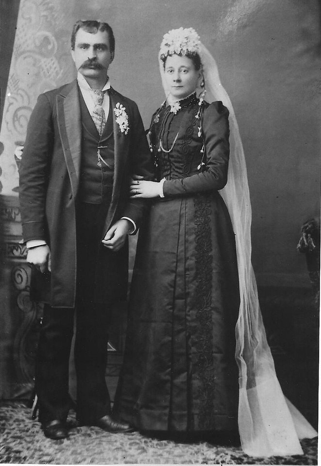 Photo - WEDDING DRESS: Queen Victoria made it popular for brides to wear white at their wedding. This was not the case for Wilhemina Sonner Pfefferle when she married her husband on Feb. 5, 1891. Pfefferle wore a black dress with a white veil. But there was nothing ordinary about their marriage. Judith Carr, Pfefferle's granddaughter, said they were true partners in their marriage. An example of this can be seen by how they are standing side by side. Photo provided by Judith Carr  Photo provided by Judith Carr - Photo provided by Judith Carr