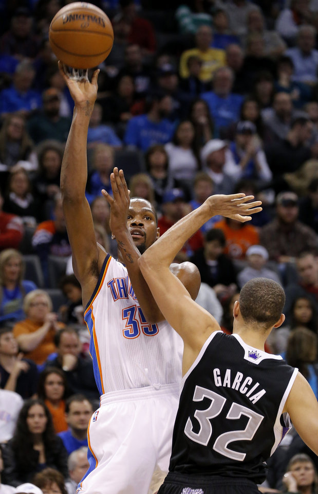 Oklahoma City's Kevin Durant (35) is fouled as he shoots over Sacramento's Francisco Garcia (32)  during an NBA basketball game between the Oklahoma City Thunder and the Sacramento Kings at Chesapeake Energy Arena in Oklahoma City, Friday, Dec. 14, 2012. Photo by Bryan Terry, The Oklahoman