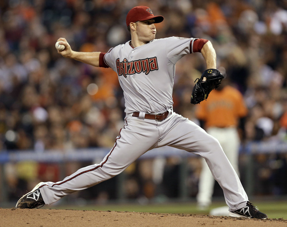 Arizona Diamondbacks starting pitcher Ian Kennedy throws to the San Francisco Giants during the fourth inning of a baseball game Friday, July 19, 2013, in San Francisco. (AP Photo/Marcio Jose Sanchez)