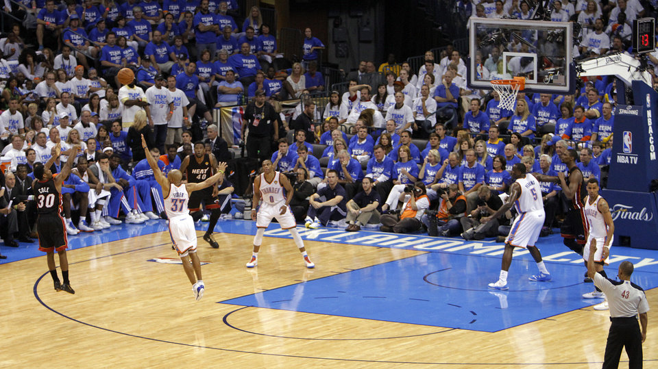 Miami's Norris Cole (30) shoots over Oklahoma City's Derek Fisher (37) during Game 2 of the NBA Finals between the Oklahoma City Thunder and the Miami Heat at Chesapeake Energy Arena in Oklahoma City, Thursday, June 14, 2012. Photo by Chris Landsberger, The Oklahoman