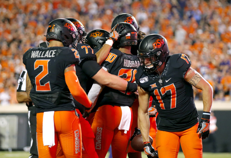 Photo - Oklahoma State celebrates a Chuba Hubbard (30) touchdown in the third quarter during the college football game between the Oklahoma State Cowboys and the Kansas State Wildcats at Boone Pickens Stadium in Stillwater, Okla., Saturday, Sept. 28, 2019. [Sarah Phipps/The Oklahoman]