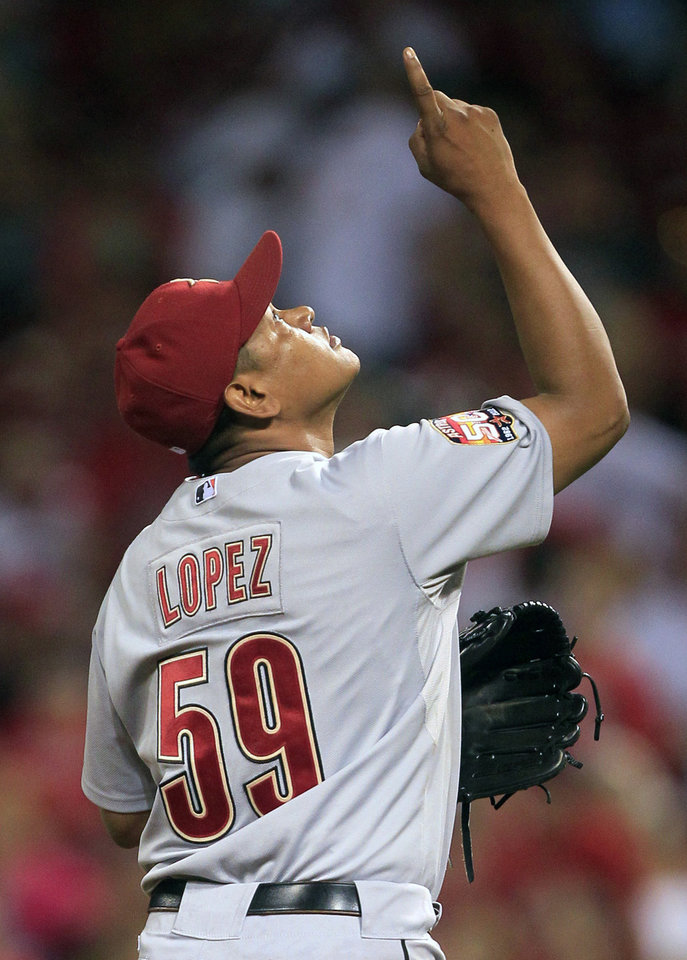 Photo -   Houston Astros relief pitcher Wilton Lopez points after the Astros defeated the Cincinnati Reds 5-3 in a baseball game, Friday, Sept. 7, 2012, in Cincinnati. Lopez earned his third save. (AP Photo/Al Behrman)