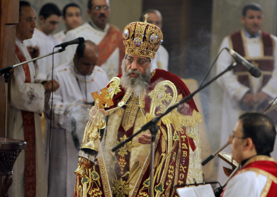 Pope Tawadros II, the 118th pope of the Coptic Church of Egypt, leads a midnight Mass on the eve of Orthodox Christmas at St. Mark's Cathedral in Cairo, Egypt, late Sunday Jan. 6, 2013. (AP Photo/Amr Nabil) ORG XMIT: AMR102