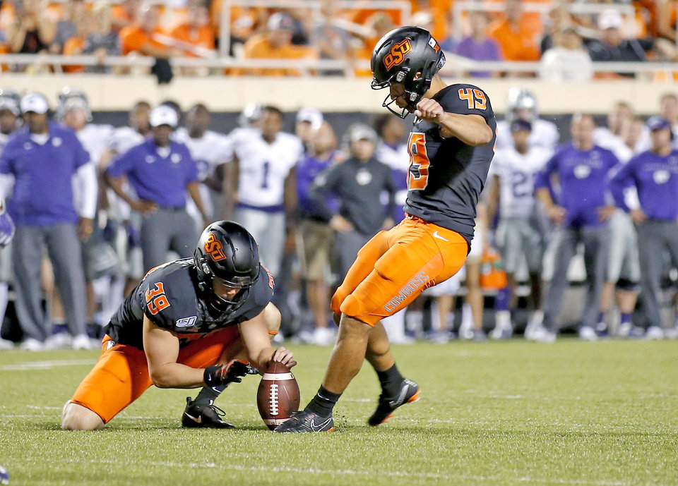 Photo - Oklahoma State's Matt Ammendola (49) kicks a field goal as Jake McClure (39) holds in the fourth quarter during the college football game between the Oklahoma State Cowboys and the Kansas State Wildcats at Boone Pickens Stadium in Stillwater, Okla., Saturday, Sept. 28, 2019.  OSU won 26-13. [Sarah Phipps/The Oklahoman]
