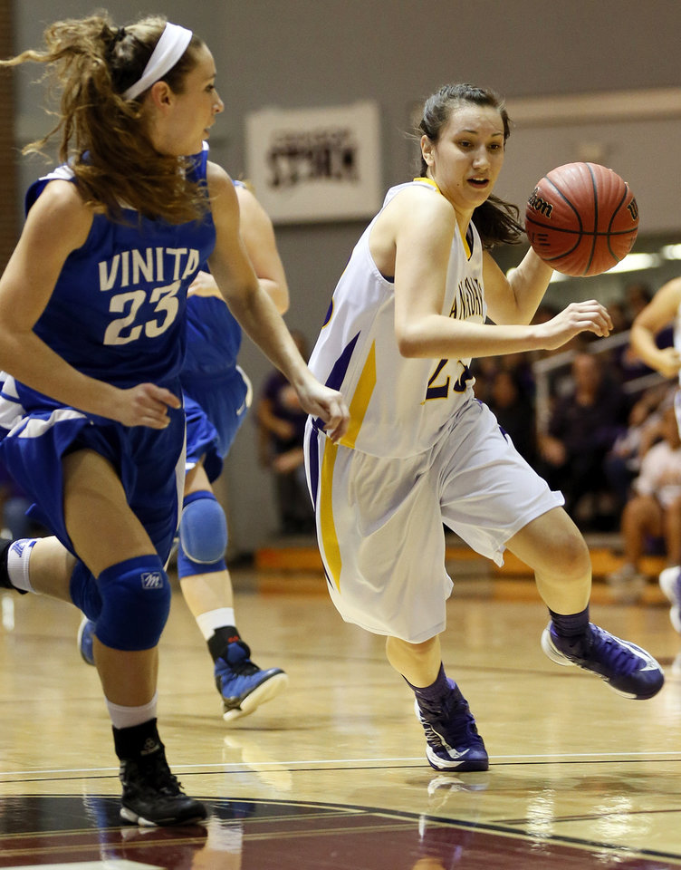 Anadarko's Lakota Beatty (23) drives against Sydney Hopwood (23) of Vinita during a Class 4A girls high school basketball game in the first round of the state tournament at the Sawyer Center on the campus of Southern Nazarene University in Bethany, Okla., Thursday, March 7, 2013. Photo by Nate Billings, The Oklahoman