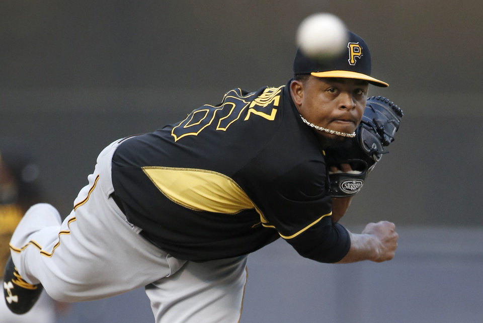 Photo - Pittsburgh Pirates starting pitcher Edinson Volquez (36) delivers a warm up pitch before facing the New York Yankees in a spring exhibition baseball game in Tampa, Fla., Friday, March 21, 2014.  (AP Photo/Kathy Willens)