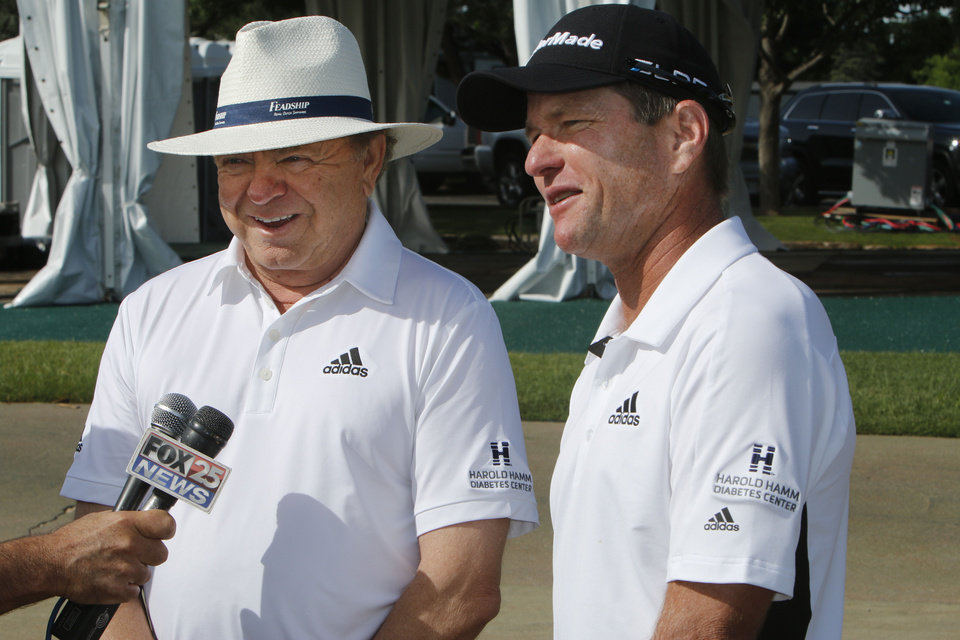 Harold Hamm, left, and Scott Verplank speak to the media before beginning the Scott Verplank Foundation Invitational at Oak Tree National in Edmond, OK, Monday, June 23, 2014, Photo by Paul Hellstern, The Oklahoman