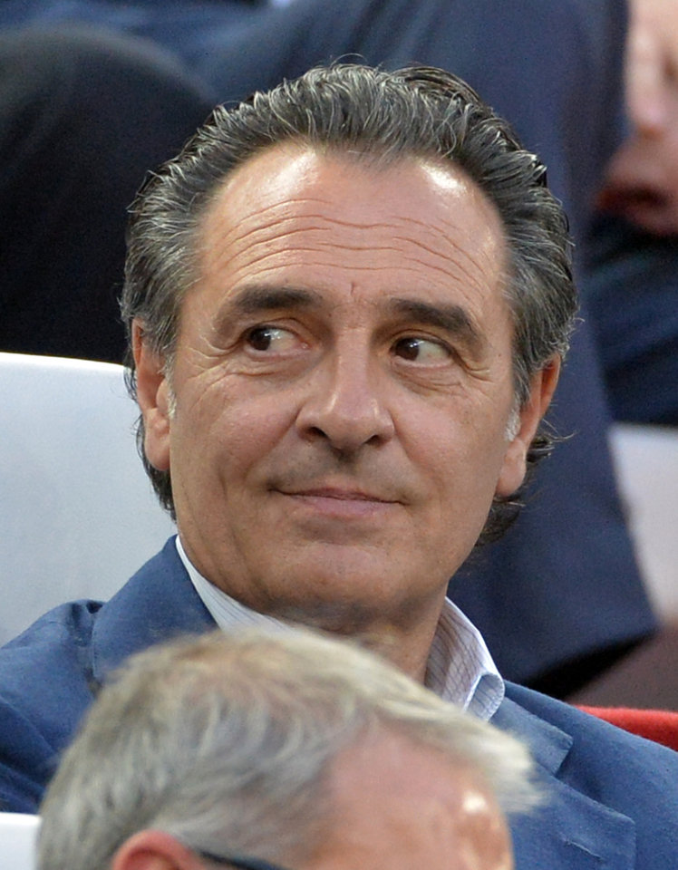 Photo - Coach of the Italian national team Cesare Prandelli follows the Europa League soccer final between Sevilla and Benfica, at the Turin Juventus stadium in Turin, Italy, Wednesday, May 14, 2014. (AP Photo/Massimo Pinca)