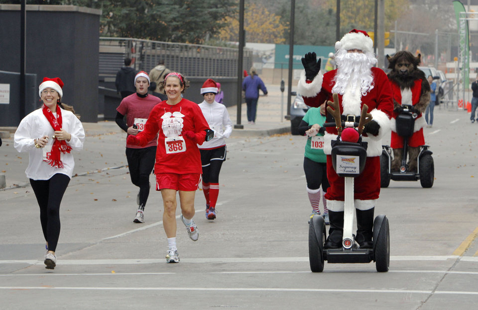 Santa rides a Segway during the SandRidge Santa Run in downtown Oklahoma City, OK, Saturday, December 8, 2012,  By Paul Hellstern, The Oklahoman
