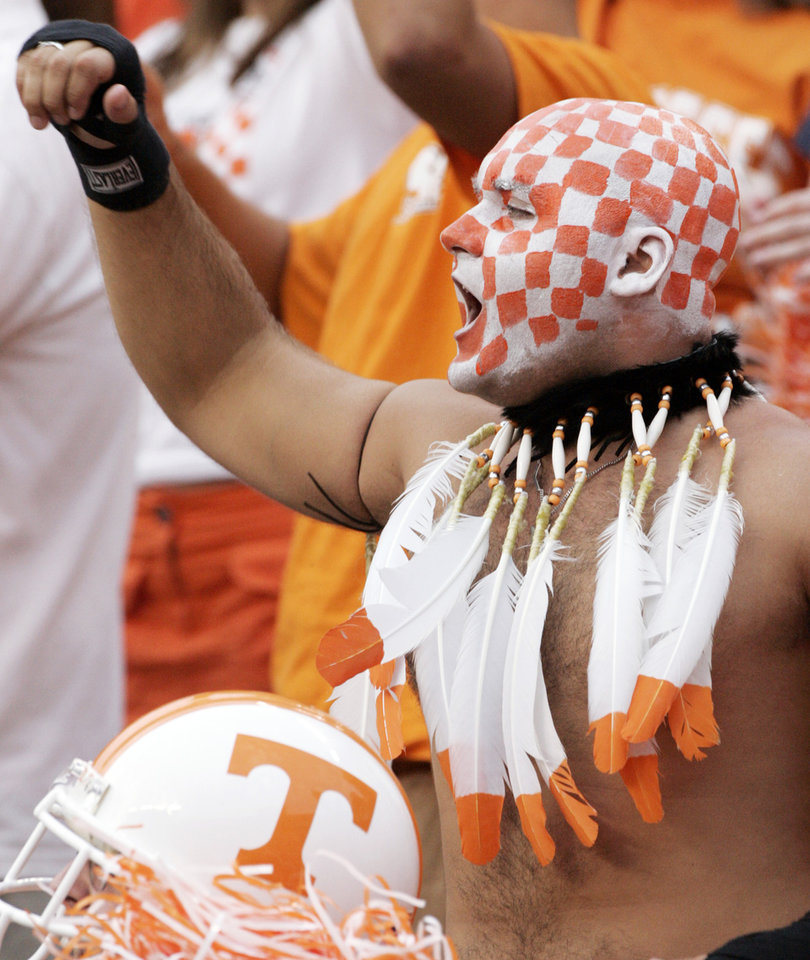 Photo - A Tennessee football fan cheers on the Volunteers Sept. 9, 2006, in Knoxville, Tenn. . Head coach Phillip Fulmer has said that the Vol's losing season in 2005 was an aberration, and the Volunteers are so far proving him right this season with a potent offense that's doing a pretty good impression of the days of Heath Shuler and Peyton Manning. (AP Photo/ Mark Humphrey) ORG XMIT: TNMH103