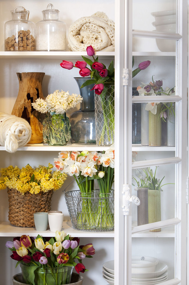 Photo - Think outside the vase when considering a container for your arrangement. Look for items in your home you can repurpose, such as an old watering can, wicker basket or mason jar. Photo provided by iBulb.  W.H. Zandbergen