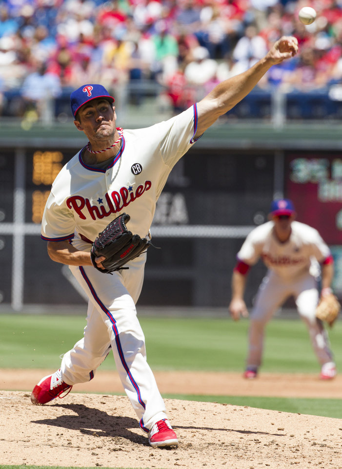 Photo - Philadelphia Phillies starting pitcher Cole Hamels pitches during the third inning of a baseball game against the San Francisco Giants, Thursday, July 24, 2014, in Philadelphia. (AP Photo/Chris Szagola)