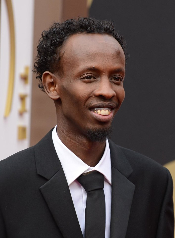 Photo - Barkhad Abdi arrives at the Oscars on Sunday, March 2, 2014, at the Dolby Theatre in Los Angeles.  (Photo by Jordan Strauss/Invision/AP)
