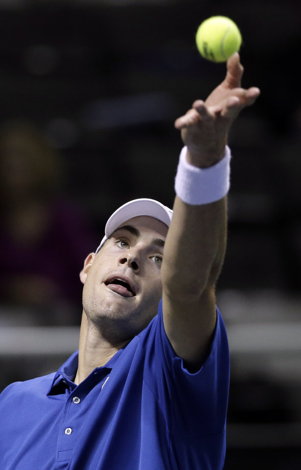 John Isner, of the United States, serves to Xavier Malisse, of Belgium, at the SAP Open tennis tournament in San Jose, Calif., Friday Feb. 15, 2013. Isner won 7-6 (8), 6-2. (AP Photo/Marcio Jose Sanchez)