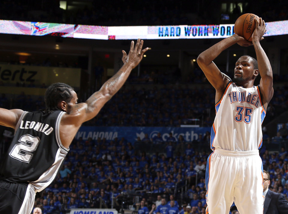 Photo - Oklahoma City's Kevin Durant (35) shoots as San Antonio's Kawhi Leonard (2) during Game 3 of the Western Conference Finals in the NBA playoffs between the Oklahoma City Thunder and the San Antonio Spurs at Chesapeake Energy Arena in Oklahoma City, Sunday, May 25, 2014. Photo by Bryan Terry, The Oklahoman