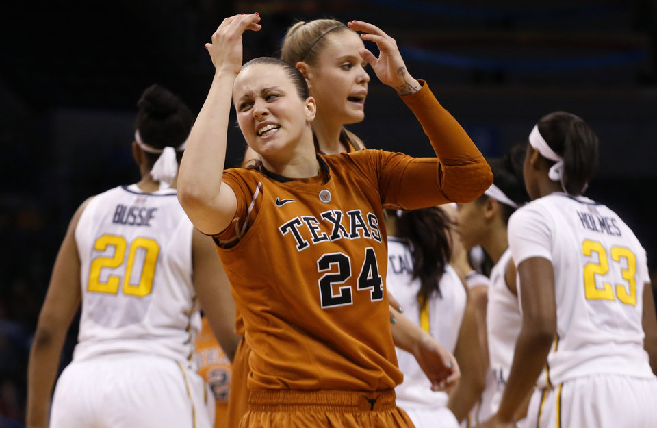 Photo - Texas guard Chassidy Fussell (24) reacts to fouling out in the second half of an NCAA college basketball game against West Virginia in the semifinals of the Big 12 Conference women's tournament in Oklahoma City, Sunday, March 9, 2014. West Virginia won 67-60. (AP Photo/Sue Ogrocki)